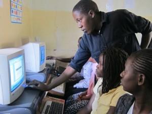AVC Volunteer Rasheed Makamba with his students at Salama Center