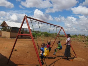 Lilian pushes her students on the swings during play time at Comfort Women's Center