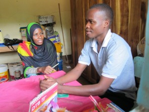Samweli Daudi with a coworker at his placement site UWAWAYAKI in Moshi, Tanzania.
