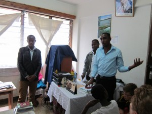 Laurent (right) speaks to a group of visitors at the KIVINET office in Moshi.